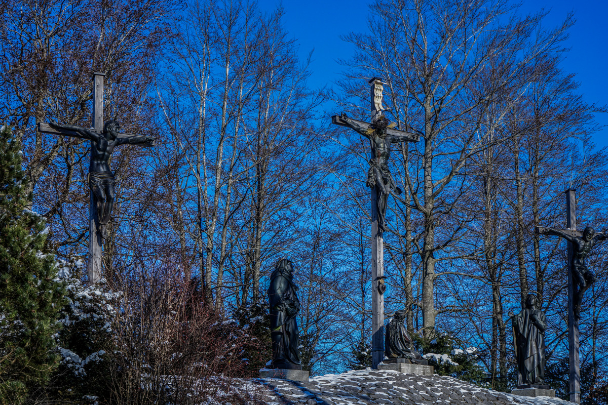 By the roadside # 1277 Bad Tölz, February 13, 2021: The Calvary in Bad Tölz with the Golgotha Hill on which a monumental, larger-than-life crucifixion group stands. The Christ figure dates from 1721 by Martin Hammerl. The two thieves were added in 1860, created by Paul Weiß, and in 1872 the sculptures of Mary, John and Mary Magdalene by Saturnin Kiene.