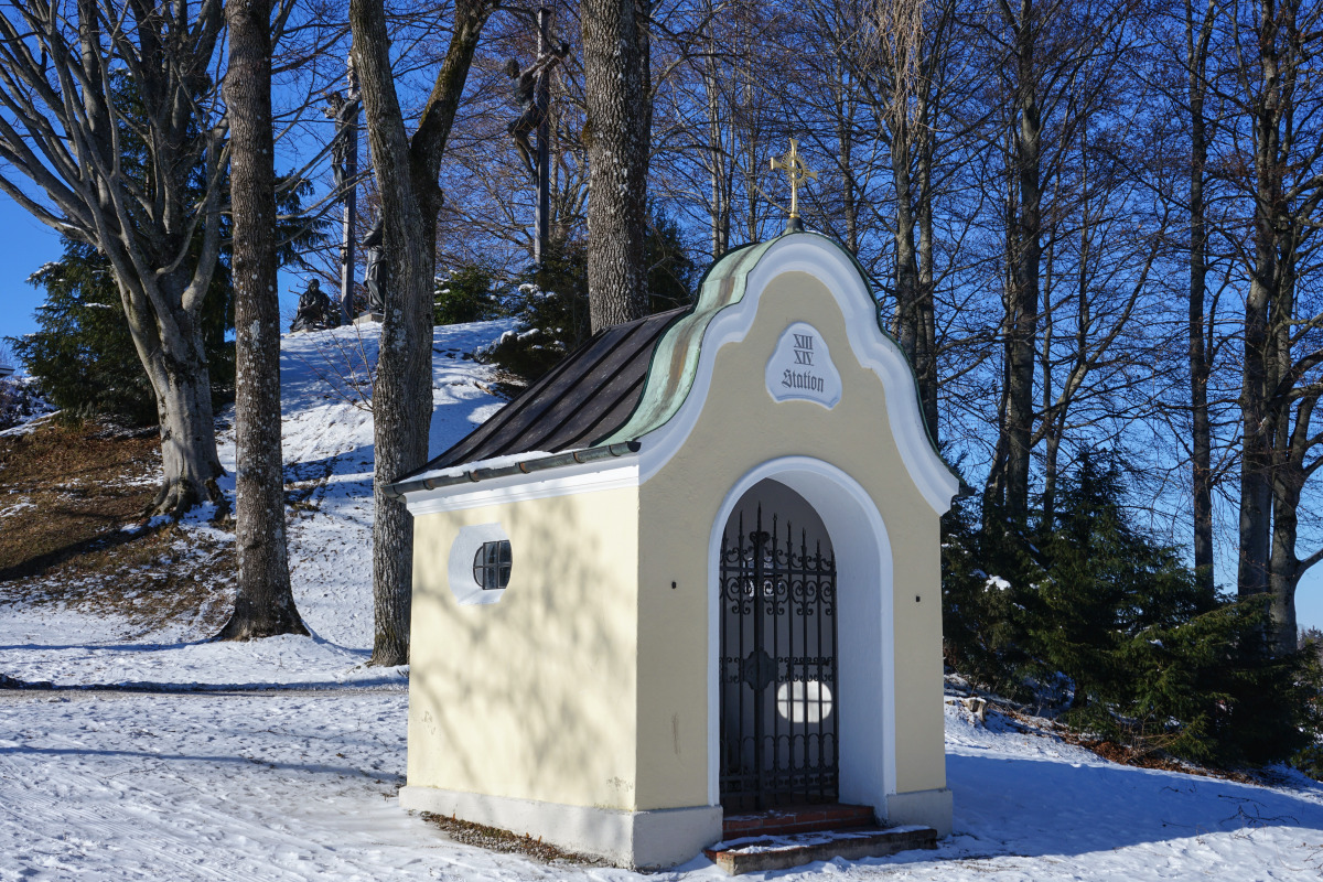 By the roadside # 1278, Bad Tölz,, February 13, 2021: Way chapel on Calvary Hill with a view of Golgotha Hill. In 1718, Friedrich Nockher donated seven wayside chapels for the representation of the